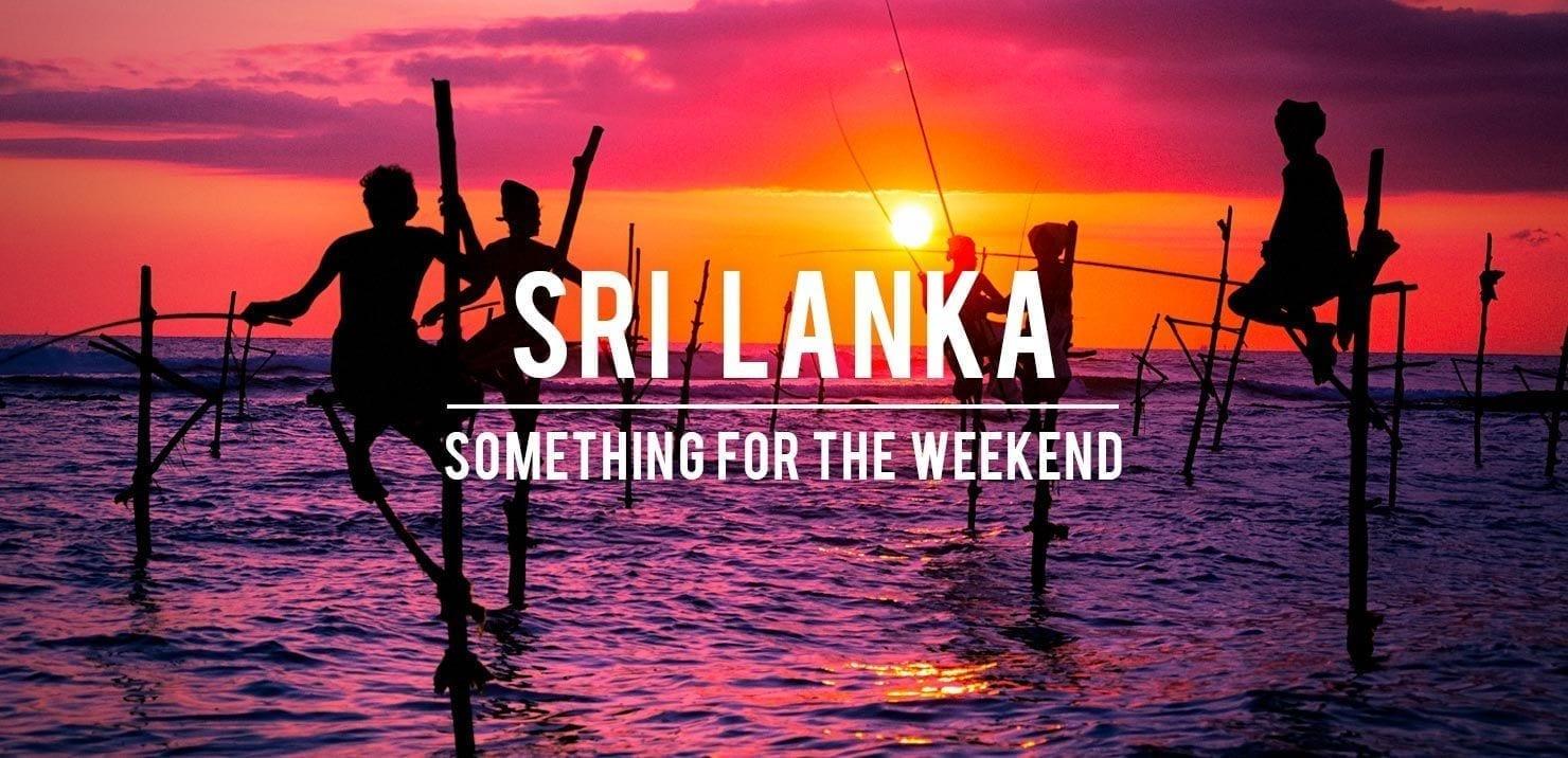 Traditional Sri Lankan stilt fishermen at sunset