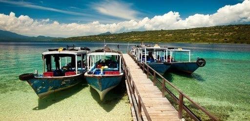 Dive boats wait at the dock on Menjangan Island, Bali