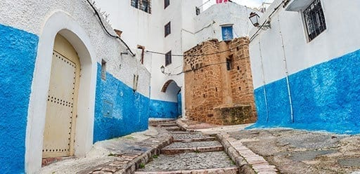 PMGY Volunteer in Morocco walking down a cobbled street of Kasbah Les Oudaias during their Volunteer work in Morocco