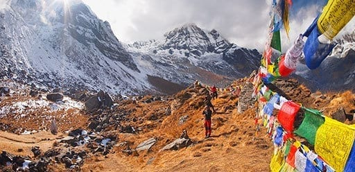 Prayer flags and trekkers in the Nepalese Himalaya