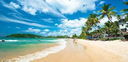 PMGY Volunteer Weekend trips in Sri Lanka walking the white sand beaches of Hikkaduwa during their Volunteer work in Sri Lanka