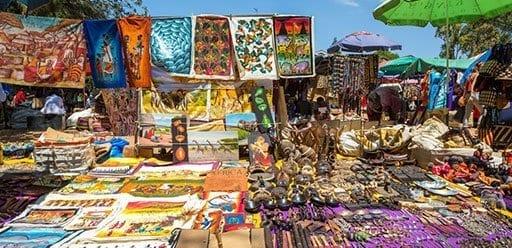 PMGY Volunteer Weekend trips in Tanzania haggling at the colourful Maasai Market during their Volunteer work in Tanzania