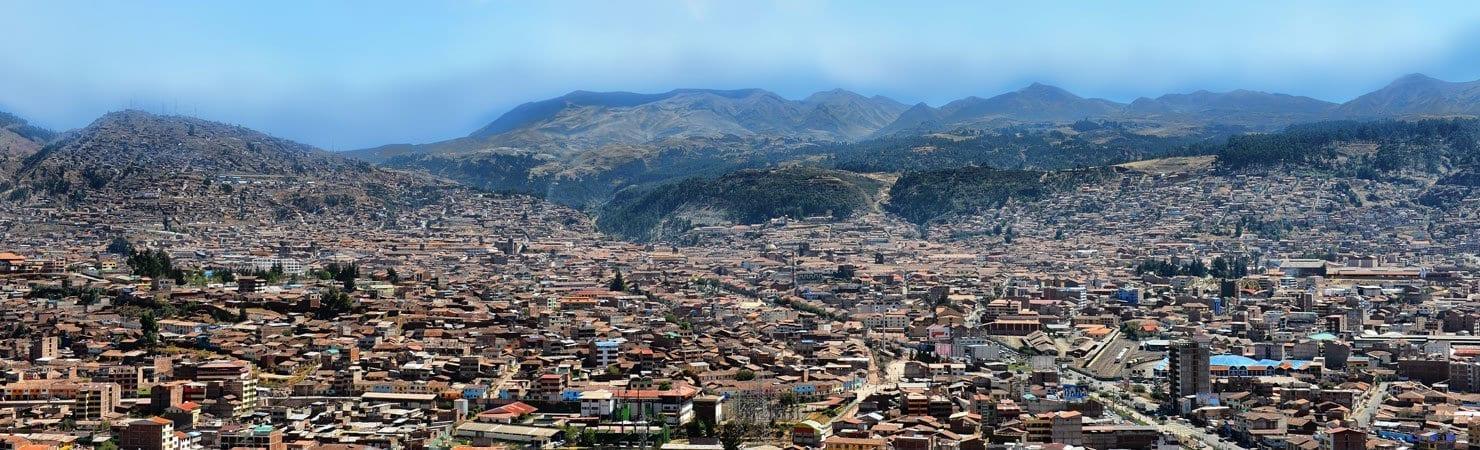 PMGY Volunteer Weekend trips in Peru overlooking Cusco city and Mountains during their Volunteer work in Peru