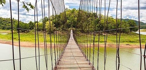 PMGY Volunteer Weekend trips in Thailand exploring local sites by rope bridge during their Volunteer work in Thailand
