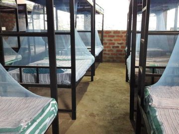 PMGY Volunteer dormitory style room with bunk beds and mosquito nets in the Volunteer House for an Elephant Volunteer in Sri Lanka, based near Wasgamuwa National Park