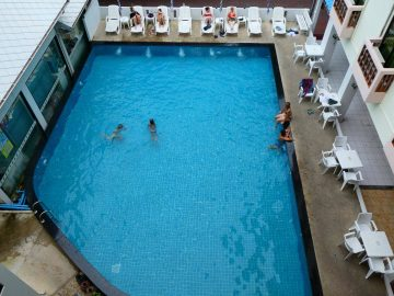 Volunteers enjoying the swimming pool and sunbeds in the Volunteer abroad accommodation on the PMGY Thailand Intro Experience