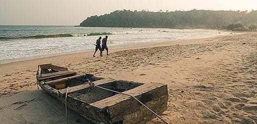 PMGY volunteer in Ghana enjoying sunrise at Busua Beach during their volunteer weekend trips in Ghana