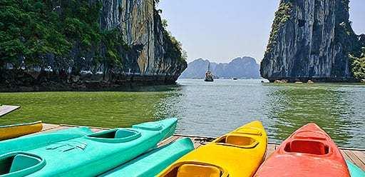 PMGY volunteer in Vietnam kayaking in Ha Long Bay during their volunteer weekend trips in Vietnam