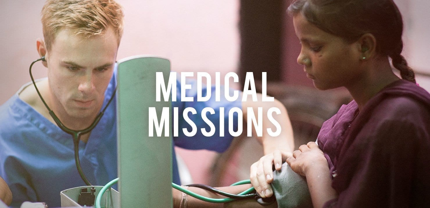 PMGY medical mission participant in Asia taking patient vitals on the Gap Year Volunteer Abroad Programs