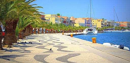 PMGY volunteer in Greece walking on the Argostoli promenade during their volunteer weekend trips in Greece