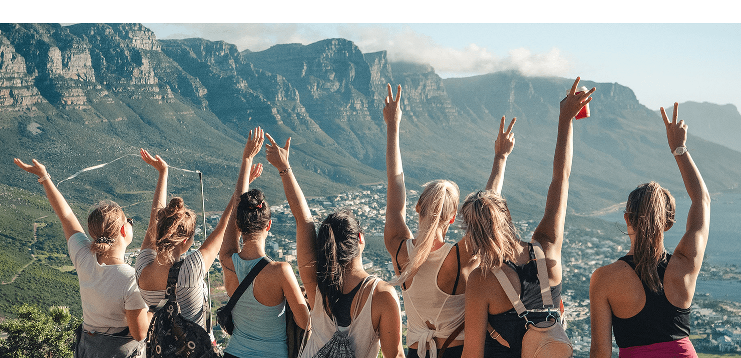 Girls celebrating on Lions Head in South Africa